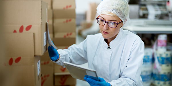 Laboratory supervisor performing manual inventory without a lab inventory management system