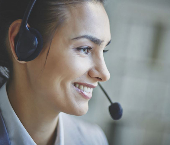 Operator with headset helping to resolve issues with advanced remote service tools with PROService